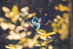 Relaxing after hiking. Sensual couple on vacation trip. Couple in love on summer vacation. woman and bearded man on. Relaxing after hiking. Sensual couple on stock photography