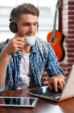 Relaxing with his favorite music. Stock Images