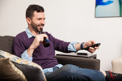 Relaxing at home with beer and tv Stock Image