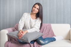 Relaxing at home, comfort. cute young woman smiling, relaxing  on white couch, sofa  at home Stock Photo