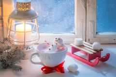 Relaxing in hot cocoa snowman made of marshmallows for Christmas royalty free stock photography