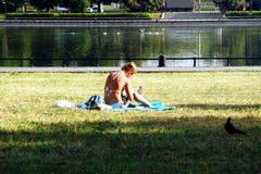 Relaxing on hot summer day in the city by the water stock photography