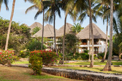 Relaxing huts. In an African tropical resort Stock Photography