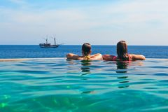 Free Relaxing In Infinity Swimming Pool With Sea View Stock Photos - 103789793