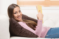 Relaxing with interesting book. Royalty Free Stock Image