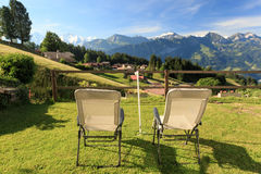 Relaxing with Interlaken mountain range View. Switzerland Royalty Free Stock Photo