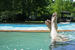 Relaxing In Jacuzzi 3. Stretching leg in jacuzzi and relaxing royalty free stock photos