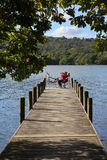 Relaxing by Lake Windermere - Lake District - England stock image