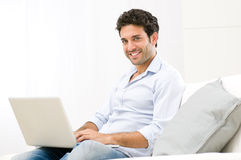 Relaxing at laptop Stock Photos