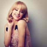 Relaxing laughing young fashion blond woman with short hair styl Stock Image