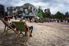 Relaxing on lazy chair by Federation Square Melbourne Victoria Australia stock image