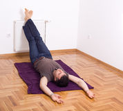 Relaxing with legs on the wall Royalty Free Stock Photography