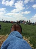 Relaxing listening to the Symphony. This evening we were relaxing under the blue sky listening to the symphony in the Flint hills Royalty Free Stock Photo