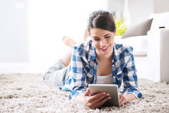 Relaxing in the living room with tablet Stock Photo