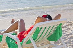 Relaxing on a lounge chair Stock Photography