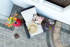 Relaxing Luxury Patio with Chair and Glass of Wine Stock Photos