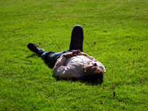 Relaxing man. Lying in the grass royalty free stock photo