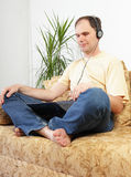 Relaxing man with laptop Royalty Free Stock Photography