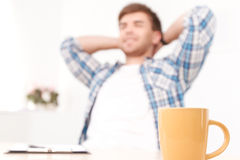 Relaxing man at the office Stock Photography
