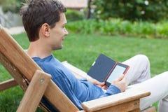 Relaxing man reading Royalty Free Stock Photo