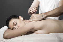 Relaxing massage at beauty spa salon Stock Image