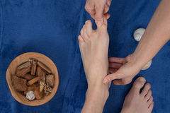Relaxing massage on the foot in spa salon Stock Image
