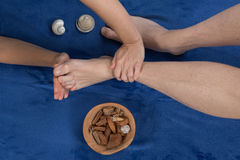 Relaxing massage on the foot  in spa salon Royalty Free Stock Image