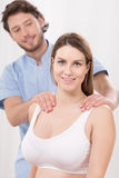 Relaxing massage on shoulders Stock Image