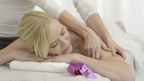 Relaxing massage at spa stock video