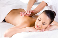 Relaxing massage for woman in spa salon Royalty Free Stock Photo