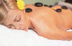 Relaxing massage for young beautiful woman Royalty Free Stock Photography