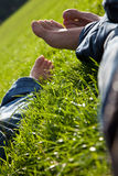 Relaxing in meadow. Couple laying in grass. Absolute relaxation Stock Images