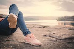 Relaxing moment Asian tourist sleeping on rock waiting for sunset. Enjoying time on holiday concept ,color of vintage tone Royalty Free Stock Image