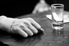 Relaxing moment at the pub. Closeup of a pub customer's hand with glass Stock Photo