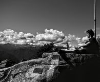 A relaxing moment on the top of Briasco mountain placed in northem of Italy. stock photography