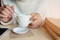 Relaxing moments , Cup of coffee and a book on wooden table in n Stock Photos