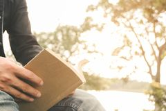 Young man opening and reading a book Stock Photography