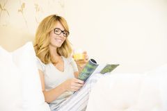 Relaxing morning in bed Stock Images