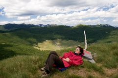 Relaxing on the mountain peek Royalty Free Stock Photo