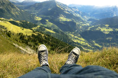 Relaxing on the mountain in Switzerland in converse Royalty Free Stock Photo