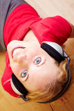 Relaxing music. Happy woman with headphones listening to music stock photo