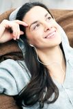 Relaxing with music. Young woman is relaxing with music Stock Images
