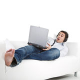 Relaxing with music on the couch Royalty Free Stock Photography