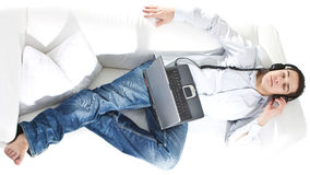 Relaxing with music on the couch Stock Photography