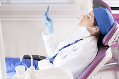 Relaxing with music at the office. Relaxing with some music at the dental office Stock Image