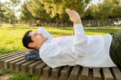 Relaxing with my smartphone Royalty Free Stock Photo