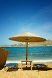 Relaxing on Mykonos beach Royalty Free Stock Photos