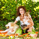 Relaxing in nature with pets Royalty Free Stock Photography