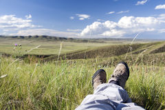 Relaxing in Nature. A view of a person relaxing in the grasslands of the Mongolian steppes Stock Photos