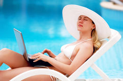 Relaxing near waterpool Royalty Free Stock Photography
